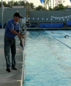 Coach Michael Collins doing some under water swimming video analysis